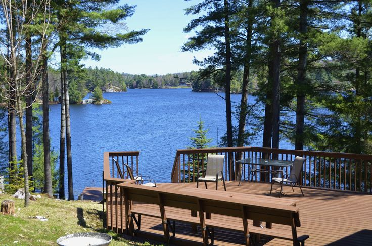 NEW PRICE-343.17A-Two cottages on spectacular point of land on Big Otter Lake. Features include 475 ft. of actual frontage, sand beach, groomed land with pine trees, fantastic 180 degree view over the big lake, boat house and dock, year round access in well-established neighborhood, gentle slope to the water and more. 2 self contained cottages with  two bedrooms each, sunroom, large decks, three car carport, wood burning wood stoves and much much more.$799,000