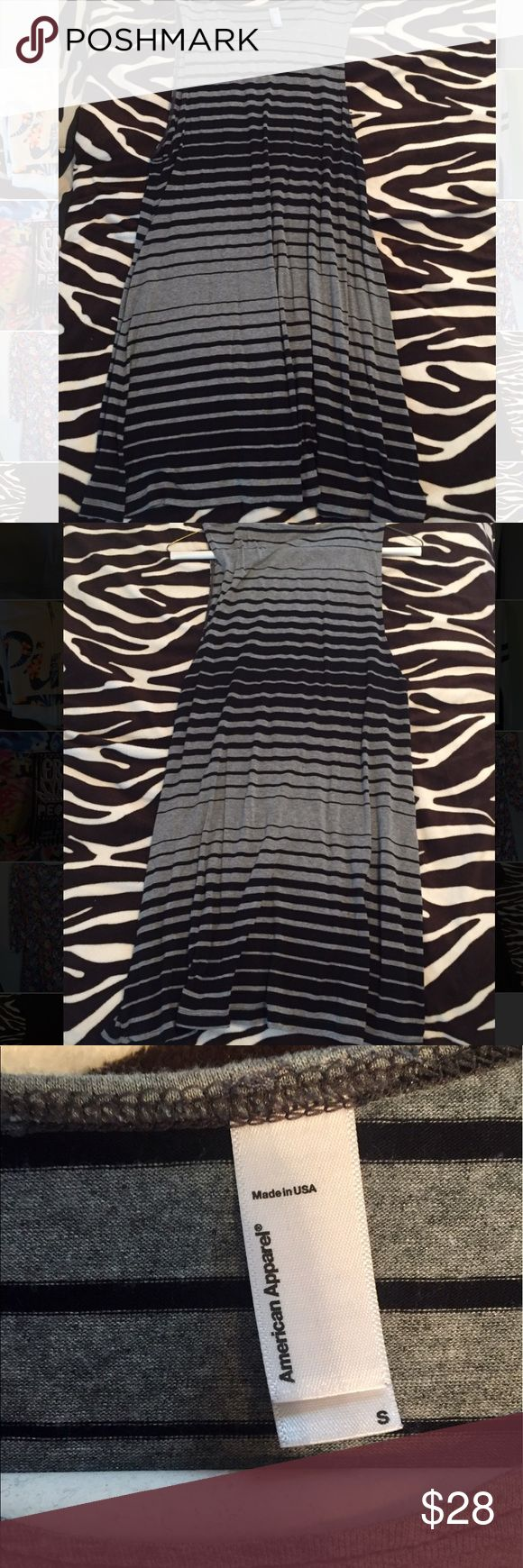 American Apparel Striped Tank Dress American Apparel grey and black stripe tank dress. Straight fit, pairs well with sneakers or sandals. Great basic piece to add to your wardrobe. Lightly used American Apparel Dresses