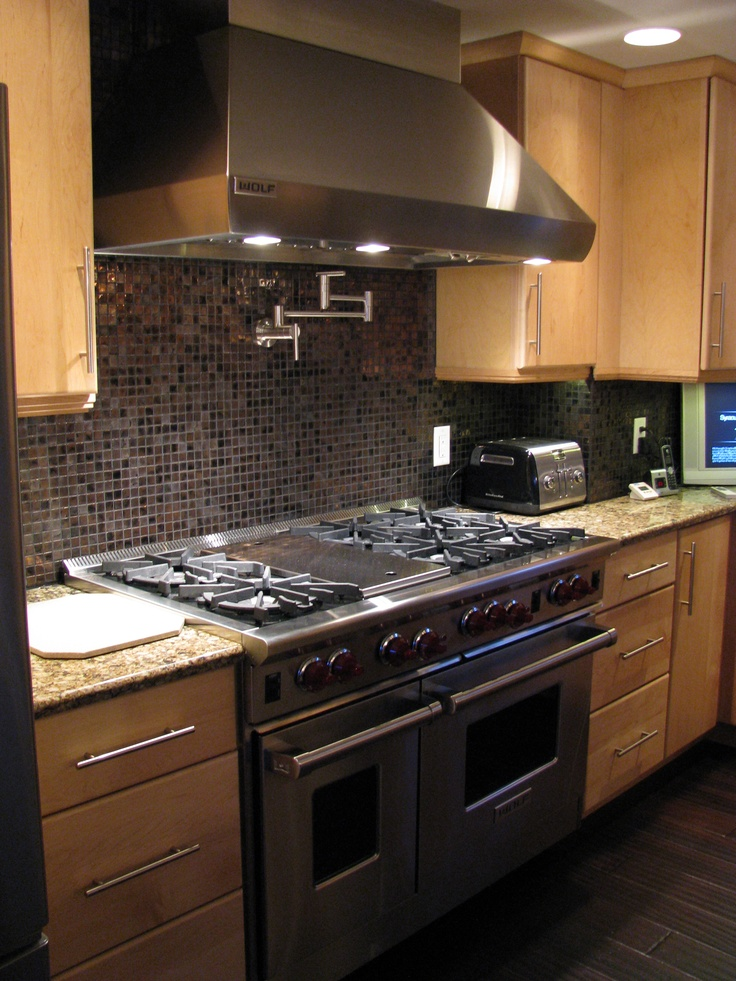 Commercial stove, glass tile, and a pot filler faucet