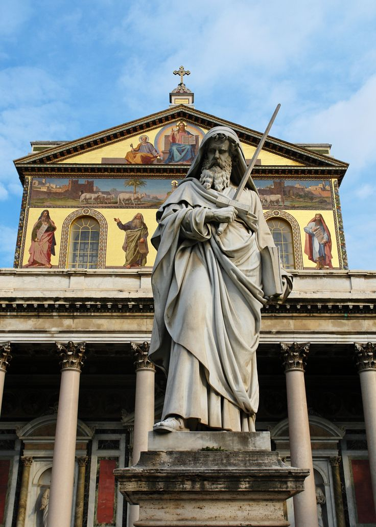 Marble statue of St Paul the Apostle at the centre of the garden, Basilica of St Paul. Outside the Walls, Rome