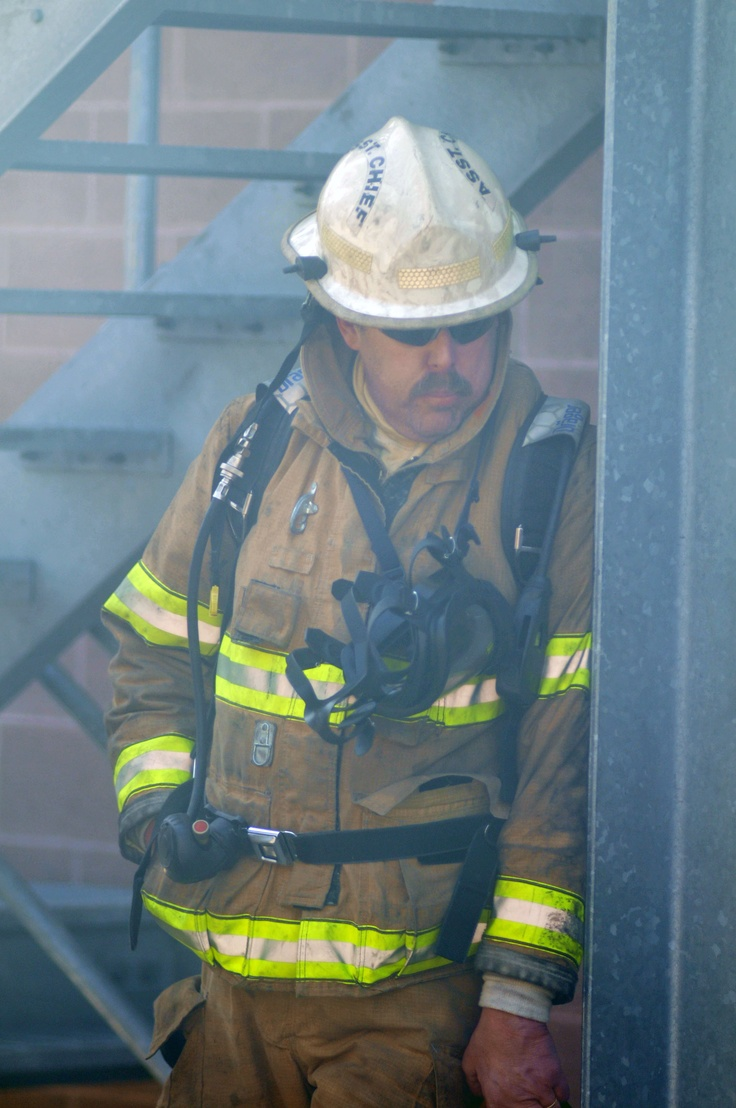 Assistant Fire Chief Jeff Dunlop of the Marion Center Volunteer Fire Department watches an evolution at Indiana County Public Safety Academy.