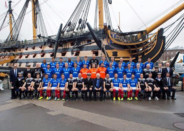 Portsmouth team photo season 2015-16 HMS Victory in the background.