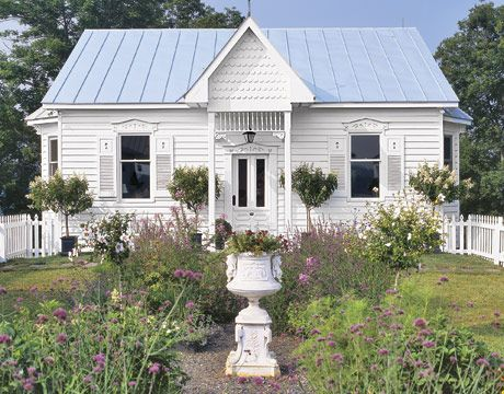 White Cottage | white cottage with blue roof and garden