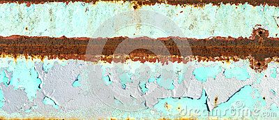 A rusty textured  metal surface with blue peeling paint and a stripe of rust through the middle.