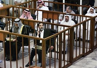 Mohammed Azawi Ali, Abdullah Kazim Ruwayyid, Saddam Hussein, (2nd row) Awad Hamed al-Bandar, Mizhar Abdullah Ruwayyid, (3rd row) Barzan Ibrahim al-Tikriti, Ali Dayih Ali, and Taha Yassin Ramadan attend court as the prosecution makes its closing arguments during the trial of former Iraqi President Saddam Hussein and seven members of his regime on June 19, 2006 in Baghdad, Iraq. Hussein and seven other co-defendants are on trial for torture, illegal arrests and the killing of nearly 150 people…