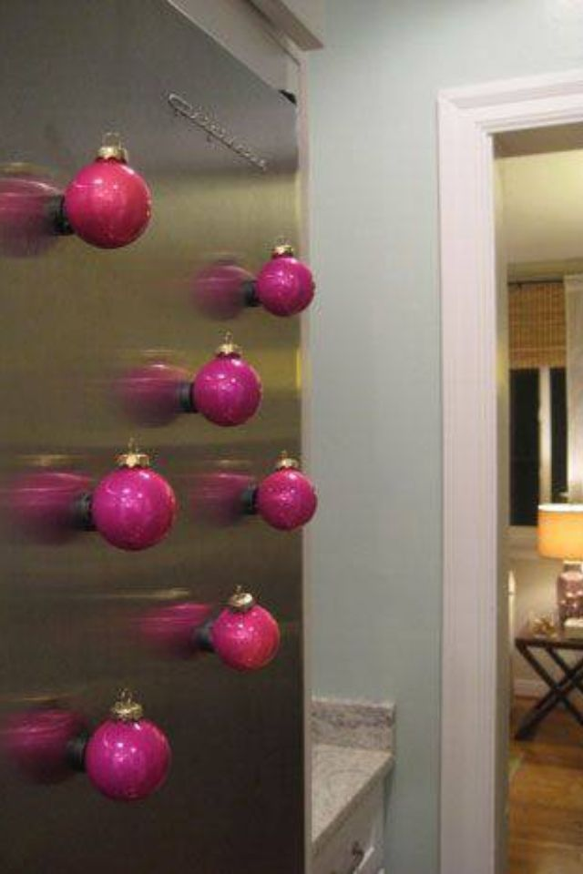 Magnets glued to Christmas ornaments. Cute way to dress up the kitchen for the holidays.