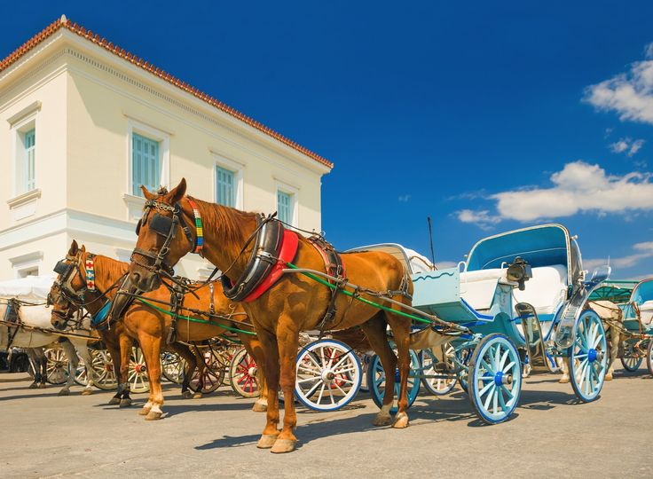 Horse drawn carts, used as taxis all over the island on Spetses, Greece