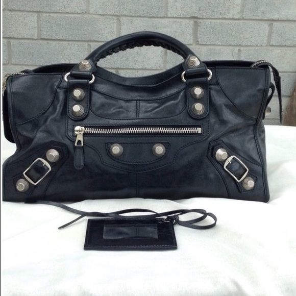 Balenciaga Part Time Purse Great black leather part time city bag with giant hardware in a nickel hardware. The leather shows some faded spots from normal wear. It comes with the Mirror but it does not come with a shoulder strap. Great bag!  Authentic. No trades. Balenciaga Bags Satchels