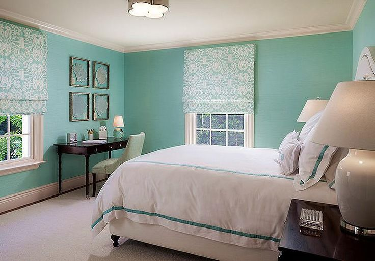 Tiffany blue bedroom features walls painted Tiffany blue lined with a white upholstered bed dressed in white and Tiffany blue hotel bedding illuminated by a nickel clover pendant, Basil Flush Mount.