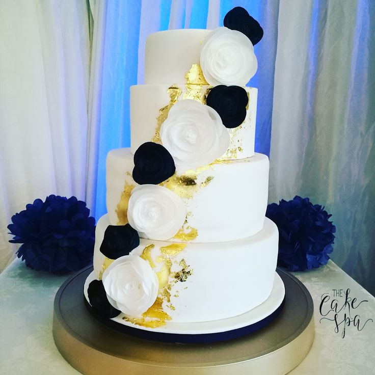 Gorgeous modern wedding cake from this weekend, loved making it, the edible gold leaf and navy go so well! And love the modern look of the wafer paper flowers. Sat on my DIY gold cake stand.