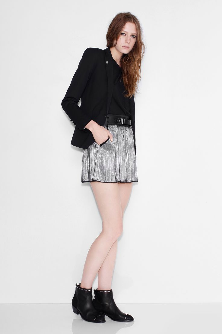 Zadig et Voltaire short silver shiny effect skirt, pleated, with an elastic belt, and side pockets, 100% polyester. Model is 183cm/ 6'0