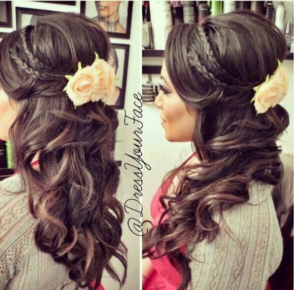 Beautiful half up do. Love the flower detail as well as the small braids, I'd prefer this with softer curls