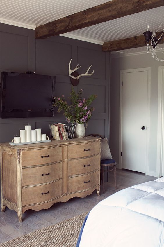 Stunning master bedroom focal wall – love the dark gray color, the beams and the bead board eclecticallyvinta…