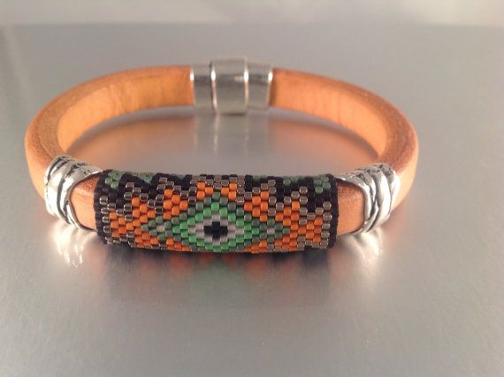 Southwestern Inspired Beaded Leather Bangle by Calisi on Etsy, $45.00  #beadwork #leather #Peyote