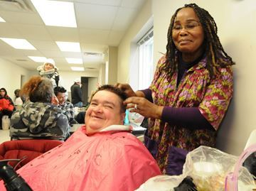 Barrie salon helps David Busby clients - Irma Young, owner of Irma's Salon, helps keep Annet Bernier, a client at the David Busby Street Centre, groomed.