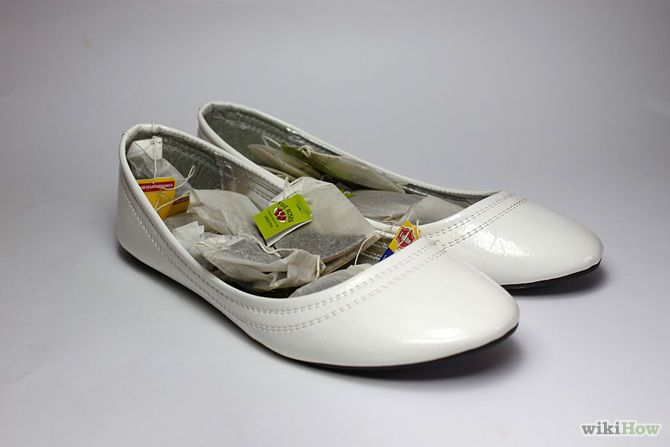 Stuff your shoes with several unused tea bags and leave for a couple of days (ideally 2-3 days for best results).