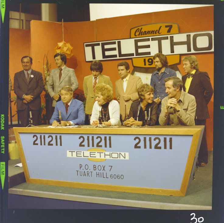 327562PD: Channel 7 Telethon panel, Perth, 1974. Back left-right: unknown man, Jeff Newman, Joe Hasham, Tom Oliver, Unknown, Johnny O'Keefe; seated: Sir James Cruthers, Pat McDonald, Bunney Brooke and Stuart Wagstaff  https://encore.slwa.wa.gov.au/iii/encore/record/C__Rb3104339