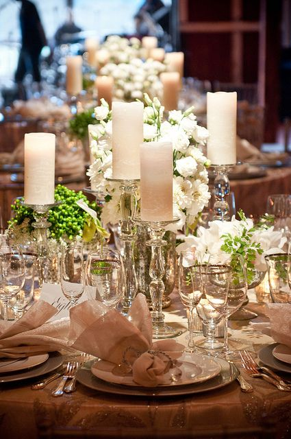 Love the tables... love the placement of candles around flowers
