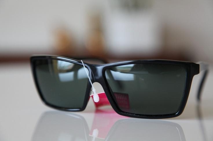 Black Tortoise frame, with Dark Green lenses, from Polaroid's Vintage Sunglasses Collection    Product ID POLAROID FACES 8740A with Polarizing Lenses