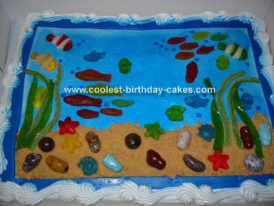 Super Easy Fish and Ocean Cake! For this Ocean cake, I started with a Costco cake with simple blue and white border, but I wanted blue frosting. Wilton's makes a food coloring spray in