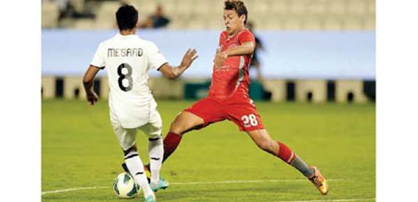 Lekhwiya's Yusuf Al Msakni (right) and Al Sadd's Mesaad Ali Al Hamad vie for the ball during their Qatar Stars League (QSL) match at Al Sadd Stadium yesterday. The match ended in a two-all draw