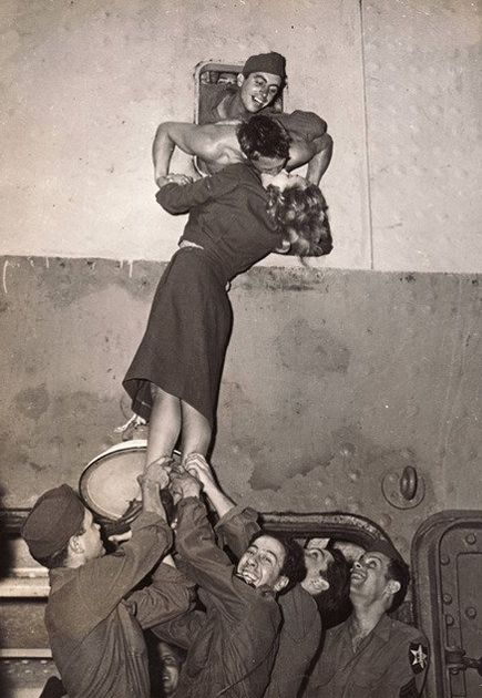 Marlene Dietrich kissing a soldier who returned home from war by Irving Haberman, 1945