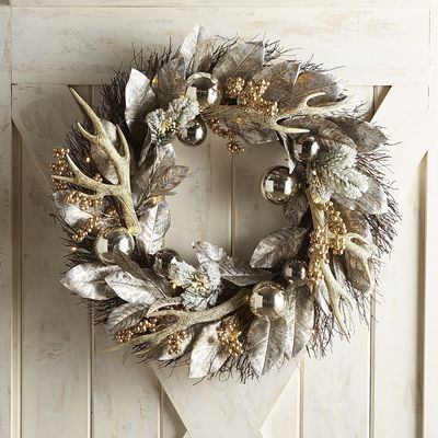 With the perfect mix of metallic and natural elements, our striking wreath provides holiday style that can't be matched. Antlers, ornaments and leaves come together in stunning silver tones, punctuated by pops of gold-toned berries, to bring unique seasonal design to your decor.