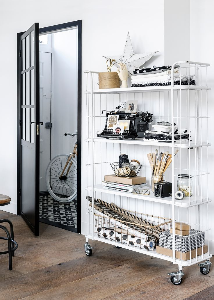 Black and white interior with wooden floor. Trolley Stock by vtwonen, stool Spider and accessoires by Livv Lifestyle, Cottonbal Shop, The Cherry on Top, Nijhof, The Bike Messenger, Hudson River and Ikea. | Styling @fransuyterlinde | Photographer Jansje Klazinga | vtwonen May 2015 | #vtwonencollectie