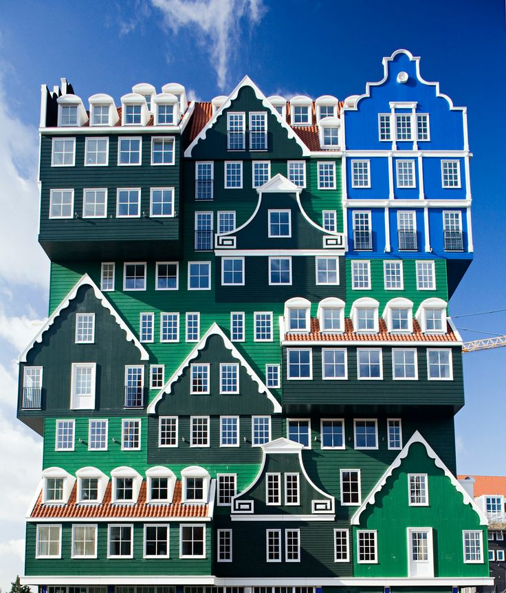 Inntel Hotel Zaandam in Amsterdam, Netherlands.  The facade of this 12-story hotel mashes together traditional building designs unique to Zaanstad.