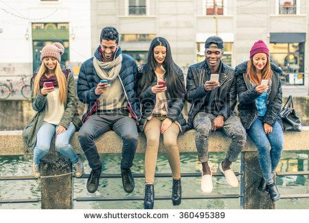 Multicultural group of friends using cellphones - Students sitting in a row and…