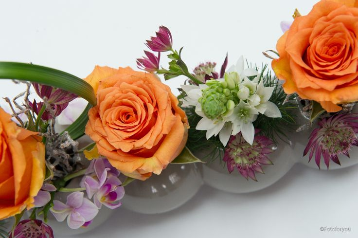 Vasetti di rose arancio