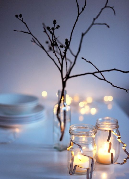 Use cookie cutters and candles placed in Mason jars to create a festive and elegant tablescape