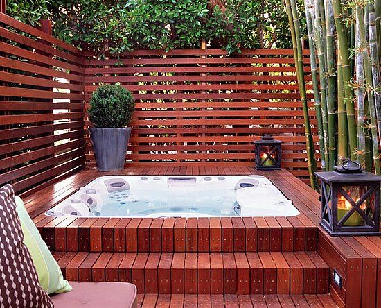 this hot tub, built into a beautiful teak floor in a fenced-in area, designed by Katie Leede, looks sophisticated!