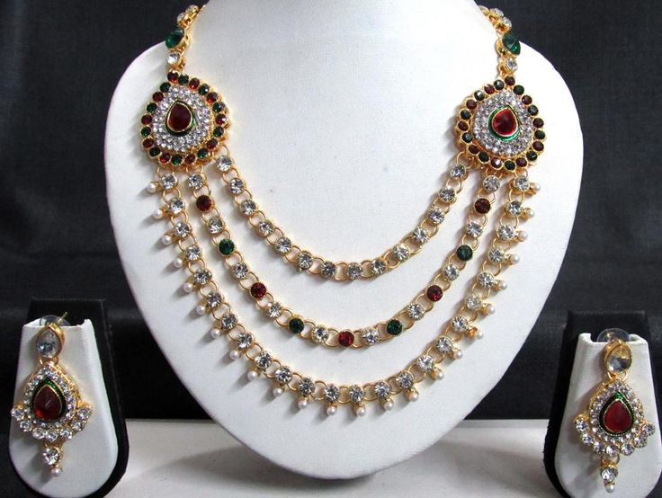 """Necklace Length : 9.5 inch + Adjustable Thread , Pendant Size : 1.5 inch , Earring Size : 0.5 inch  , Colour : Golden , Material used : Alloy and Stone , Weight : 150gm.  Designed by """"Shree Mauli Creation""""."""