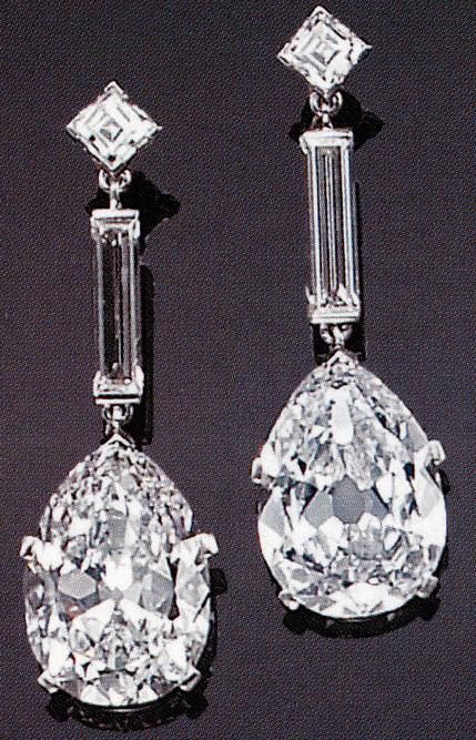 An impressive pair of diamond and platinum drop earrings, Cartier, Paris. Bonhams.