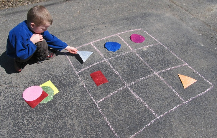 Sidewalk Sudoku is a great outdoor learning activity that teaches shapes and reinforces critical thinking skills. Rainy day? You can still play indoors with blue painter's tape.