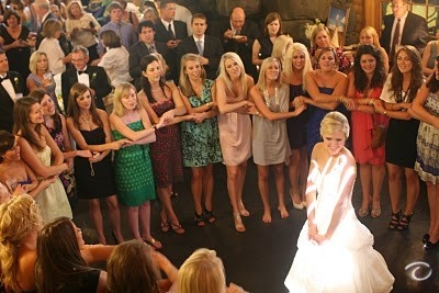 Shades, a Chi Omega wedding tradition! All sisters present at the wedding sing to the new bride!