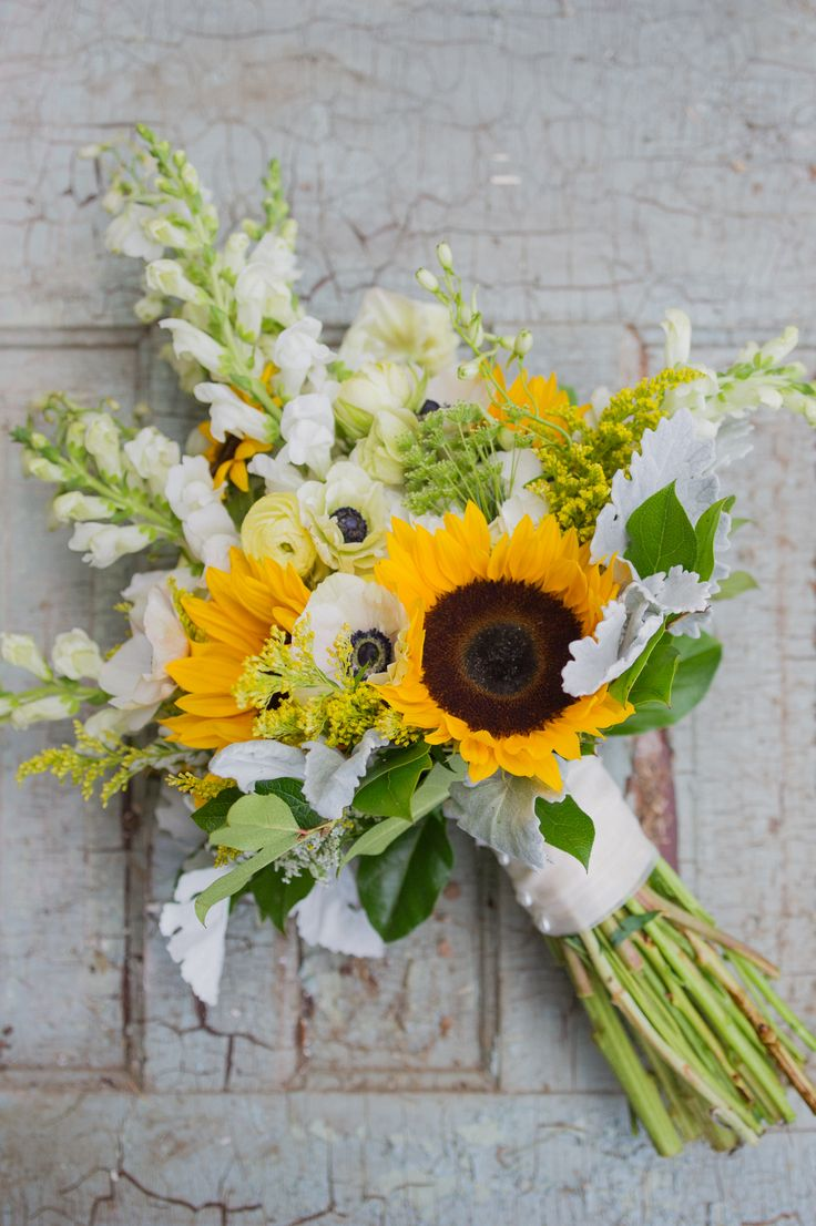 Best 25 sunflower arrangements ideas on pinterest sunflower bright sunflower and anemone bridal bouquet dhlflorist Images