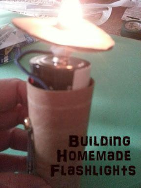 Building a homemade flashlight for Girl Scout Junior Get Moving Energy Journey. Great STEM activity for scouts.
