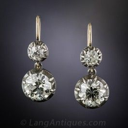 Light your path, day or night, with these ultra-sparkling antique diamond drops dangling above your shoulders. The bottom pair, weighing-in at just under 2 carats each (3.94 carats), are set in classic darkened silver half-bezel settings, and swing and sway and sizzle below a smaller matching pair totaling .65 carats - bringing the grand total to 4.59 carats. These timeless and impressive vintage drop earrings measure just shy of an inch. Stunning.