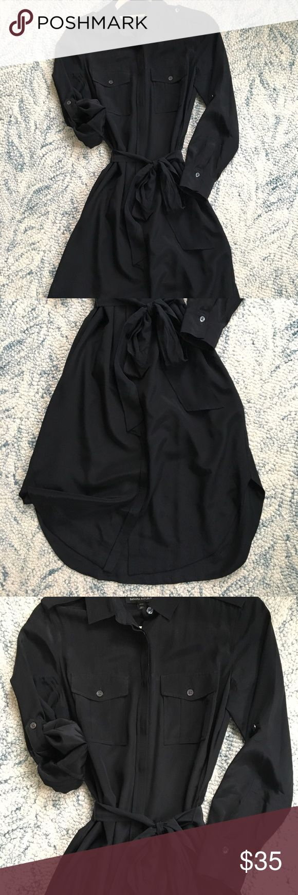 Banana Republic black silk shirt dress Banana Republic black silk shirt dress with removable belt. Sleeves can stay long or roll up with a short sleeve button. Great condition, dress never goes out of style! Banana Republic Dresses Midi