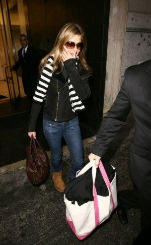 Jennifer Aniston wearing Rick Owens Leather Jacket, Tom Ford Whitney Sunglasses and Ugg Australia Classic Short Boots.