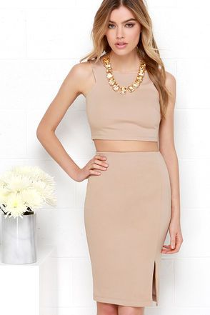 "Get the coveted crop top and matching skirt look in a snap with the Double Entendre Dark Beige Two-Piece Dress! This smooth poly stretch knit crop top has a deep sleeveless cut, a bodycon fit and side darted accents. Pair with the matching skirt, with a comfortable elastic waistband, and midi-length with side slit. Top and skirt have hidden back zippers. Fully lined. Small top measures 14"" long. Small bottom measures 23"" long. 62% Viscose, 33% Nylon, 5% Spandex. Lining: 100% Polyester. Hand…"