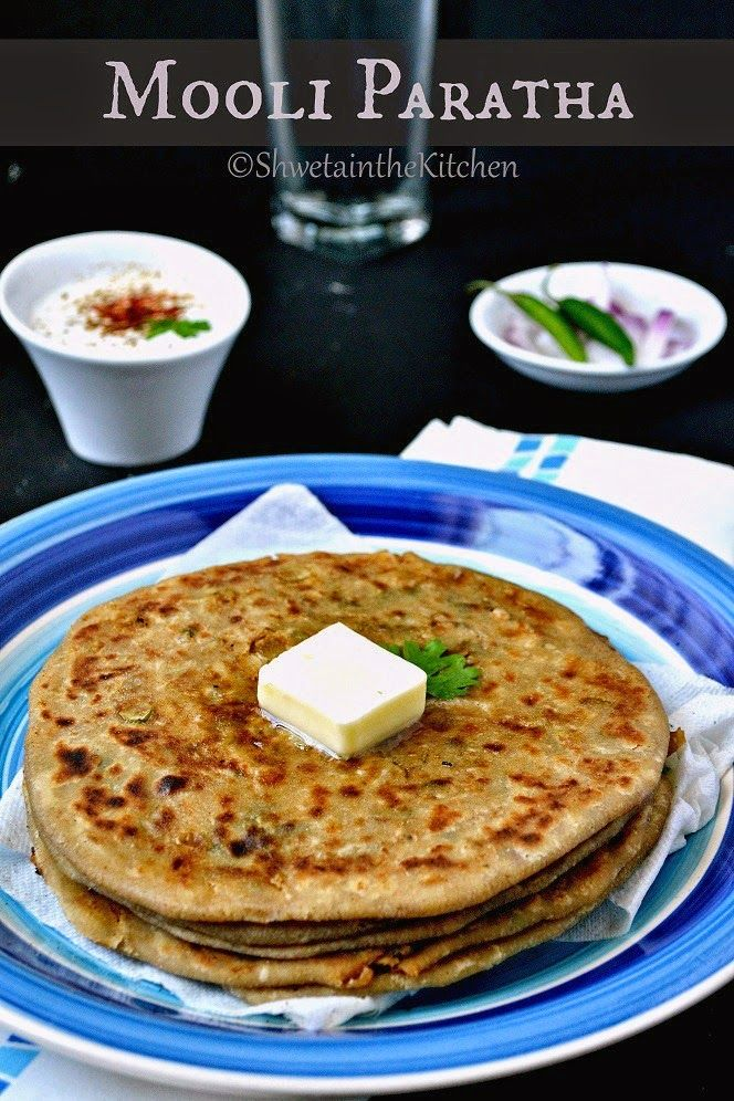 Mooli Paratha - Radish Paratha: A Popular North Indian Flatbread made by stuffing raw grated radish flavored with Indian spices. Serve it with Curd/Raita or pickle/chutney