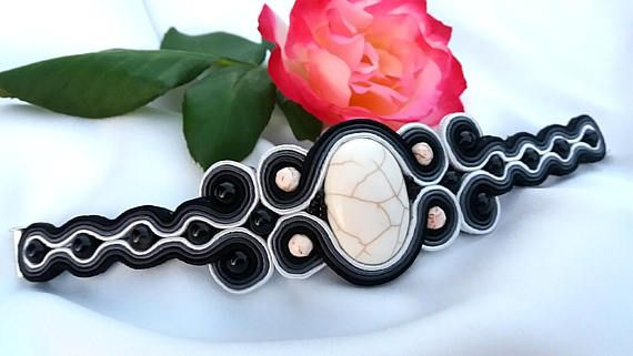 Bracelet made in soutache technique .