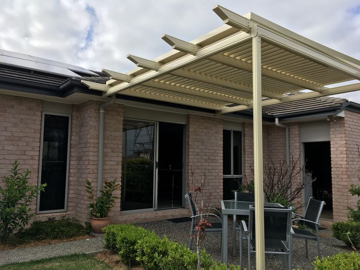 Stratco Outback Pergola with shade blades and profiled rafter ends. Supplied and installed by Brisbane Patios.