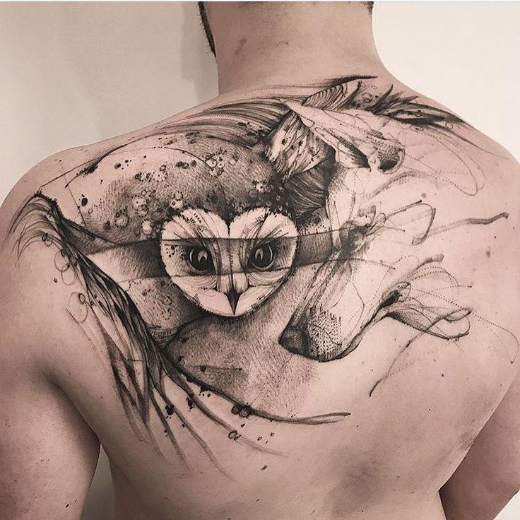 Super cool blackwork owl tattoo on back