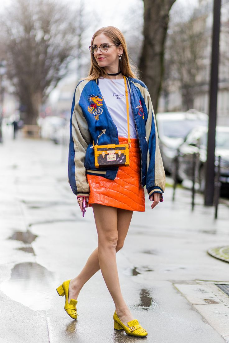 With a t-shirt, a printed jacket, and block heels.