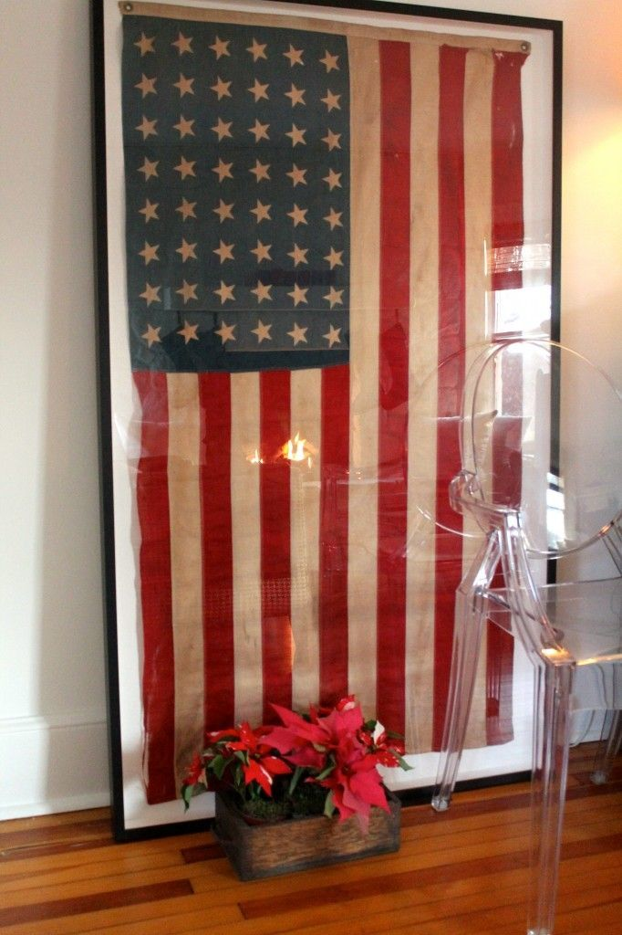 framing a vintage flag... I have one one just waiting to be framed! USING a Canada flag, of course!!