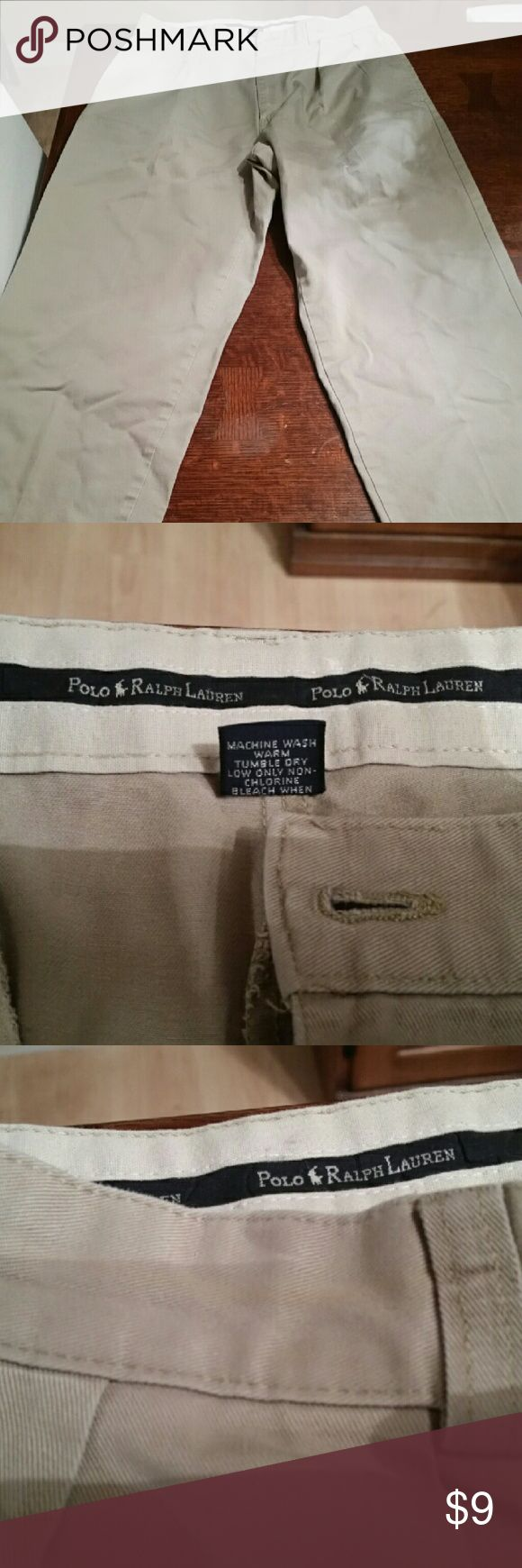 Polo Ralph Lauren Pleated Chinos 32x30 Really nice pair of Polo Ralph Lauren Pleated Chinos. There is a slight discoloration around the waist from a belt being worn with the pants but other than that, they are in excellent condition.  Pants are 100% cotton. Polo by Ralph Lauren Pants Chinos & Khakis